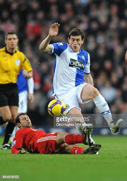 Liverpool's Javier Mascherano fouls Blackburn Rovers' Keith Andrews for the ball