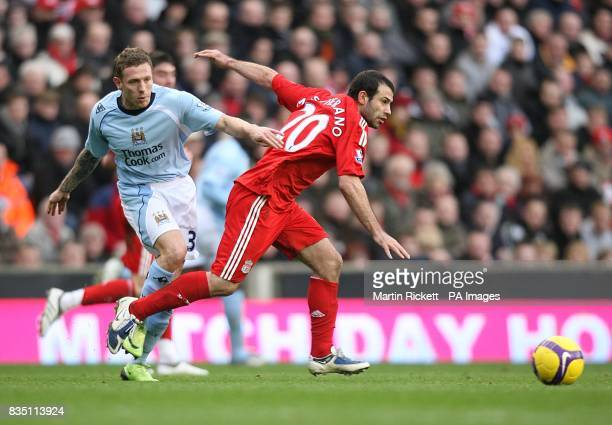 Liverpool's Javier Mascherano gets away from Manchester City's Craig Bellamy