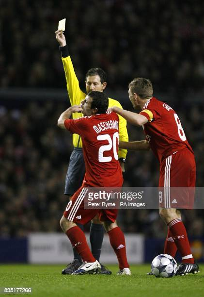 Liverpool's Javier Mascherano reacts after he is shown the yellow card by referee Frank De Bleeckere as Liverpool's Steven Gerrard argues the decision