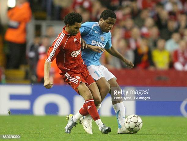 Liverpool's Jermaine Pennant and PSV Eindhoven's Jefferson Farfan battle for the ball