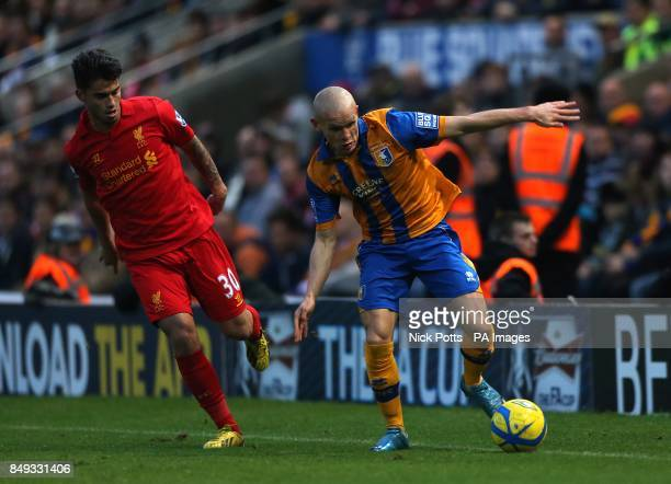 Liverpool's Jesus Fernandez Saez and Mansfield Town's Lindon Meikle battle for the ball