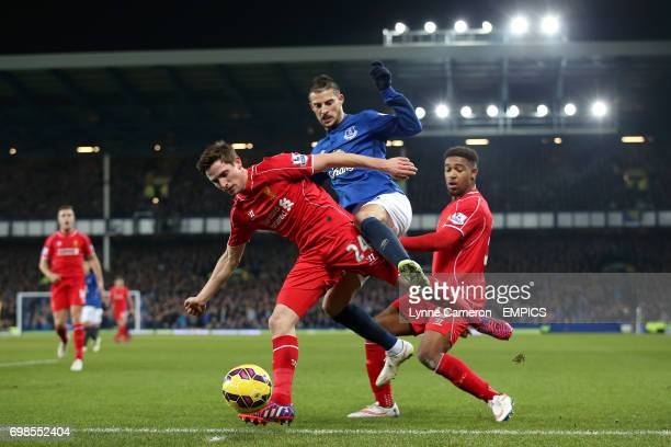 Liverpool's Joe Allen and Everton's Kevin Mirallas battle for the ball
