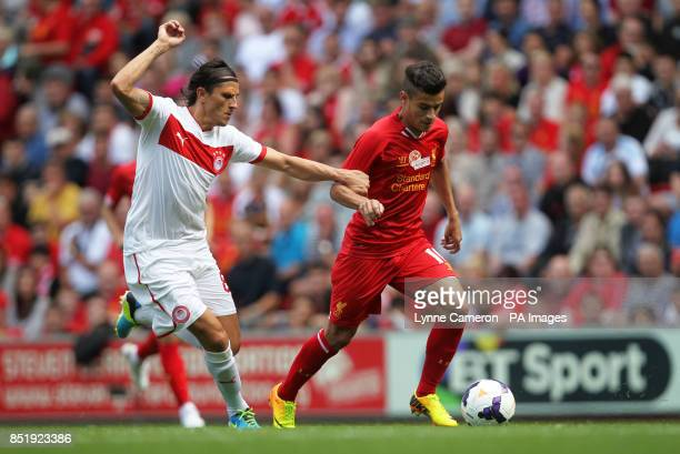 Liverpool's Joe Allen and Olmpicacos's Ljubomir Fejsa in action during the friendly at Anfield Liverpool