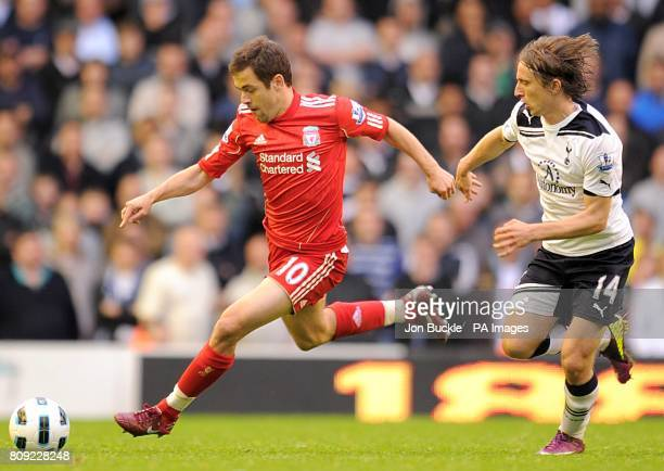 Liverpool's Joe Cole and Tottenham Hotspur's Luka Modric battle for the ball