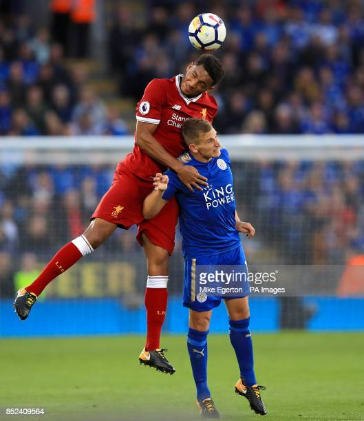 Liverpool's Joe Gomez and Leicester City's Marc Albrighton battle for the ball during the Premier League match at King Power Stadium Leicester