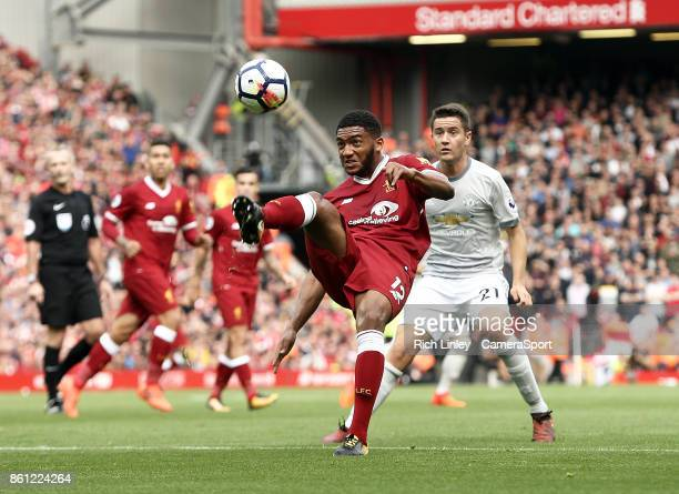 Liverpool's Joe Gomez clears under pressure from Manchester United's Ander Herrera during the Premier League match between Liverpool and Manchester...