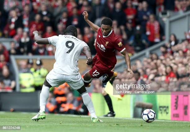 Liverpool's Joe Gomez is fouled by Manchester United's Romelu Lukaku during the Premier League match between Liverpool and Manchester United at...