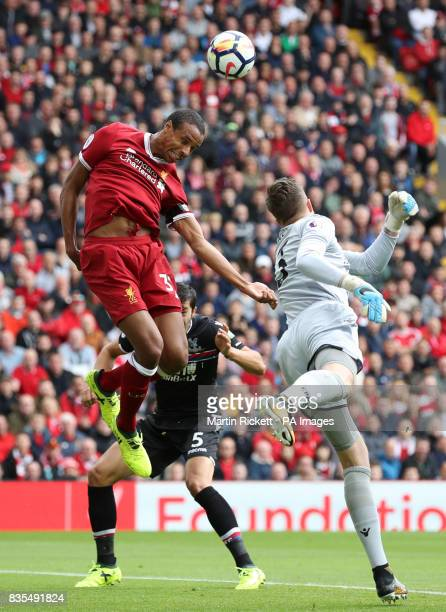 Liverpool's Joel Matip heads the ball above Crystal Palace goalkeeper Wayne Hennessey during the Premier League match at Anfield Liverpool