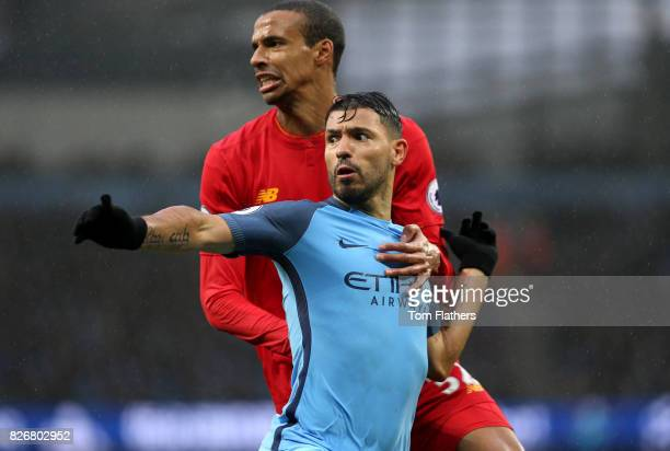 Liverpool's Joel Matip pulls back on Manchester City's Sergio Aguero