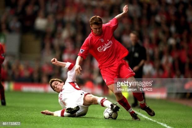 Liverpool's John Arne Riise and Charlton's Scott Parker battle for the ball