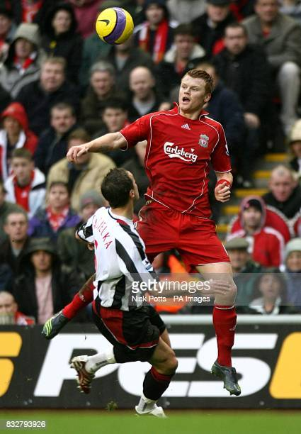 Liverpool's John Arne Riise and Sheffield United's Phil Jagielka battle for the ball