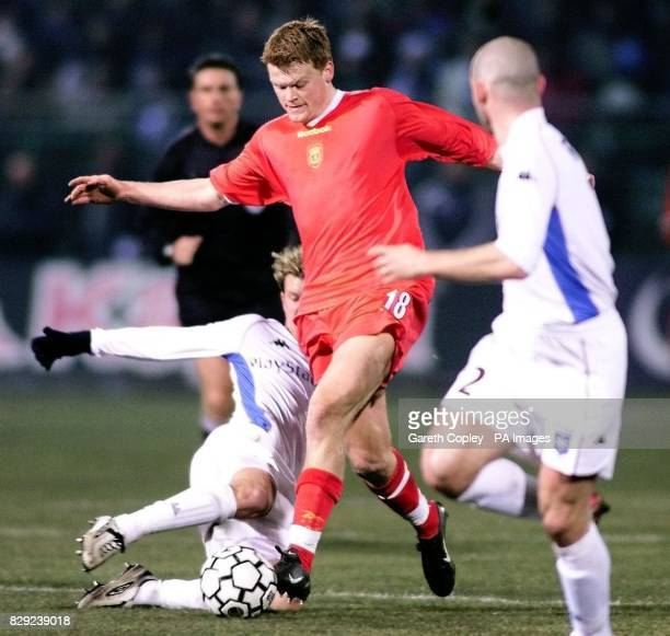 Liverpool's John Arne Riise in action against the Auxerre defence during the UEFA Cup fourth round first leg match at Abbe Deschamps Stadium Auxerre...