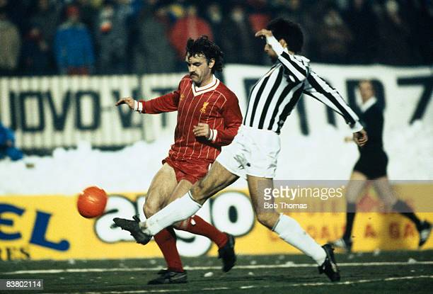 Liverpool's John Wark is challenged by Juventus capatin Gaetano Scirea during the UEFA Super Cup Final at the Stadio Comunale in Turin 16th January...