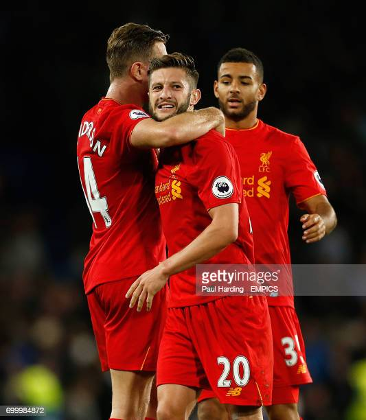 Liverpool's Jordan Henderson Adam Lallana and Kevin Stewart celebrate victory at the final whistle