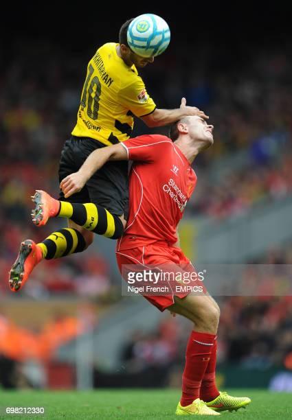 Liverpool's Jordan Henderson and Borussia Dortmund's Henrikh Mkhitaryan battle for the ball