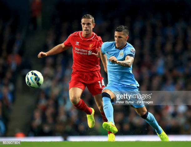 Liverpool's Jordan Henderson and Manchester City's Stevan Jovetic battle for the ball during the Barclays Premier League match at the Etihad Stadium...