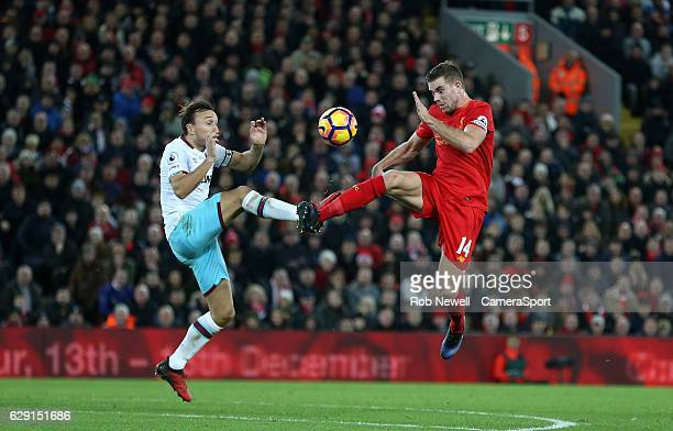 Liverpool's Jordan Henderson and West Ham United's Mark Noble during the Premier League match between Liverpool and West Ham United at Anfield on...