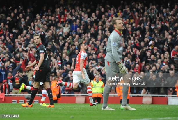 Liverpool's Jordan Henderson looks back to Liverpool goalkeeper Simon Mignolet after they concede their fourth goal scored by Arsenal's Olivier Giroud