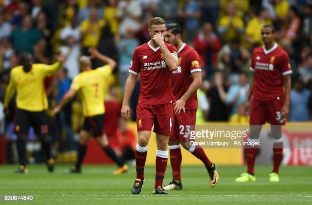 Liverpool's Jordan Henderson looks dejected after Watford's Stefano Okaka scores his side's first goal during the Premier League match at Vicarage...