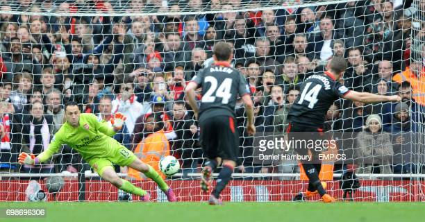 Liverpool's Jordan Henderson scores his sides first goal of the game past Arsenal goalkeeper David Ospina from the penalty spot