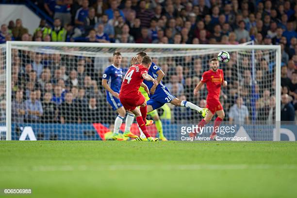 Liverpool's Jordan Henderson scores his sides second goal during the Premier League match between Chelsea and Liverpool at Stamford Bridge on...