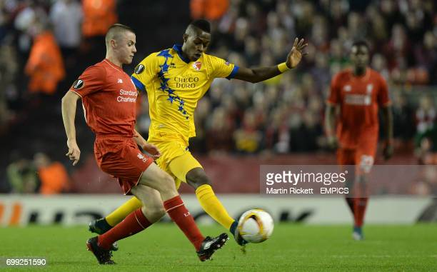 Liverpool's Jordan Rossiter battles for the ball with FC Sion's Edimilson Fernandes