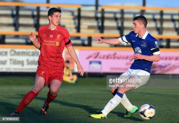 Liverpool's Jordan Williams makes his pass as he is challenged by Everton's Connor Grant