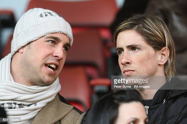 Liverpool's Jose Reina and team mate Fernando Torres in the stands
