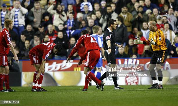 Liverpool's Jose Reina appeals to the referee against the penalty decision as his team mates point outside the area to where the foul was committed