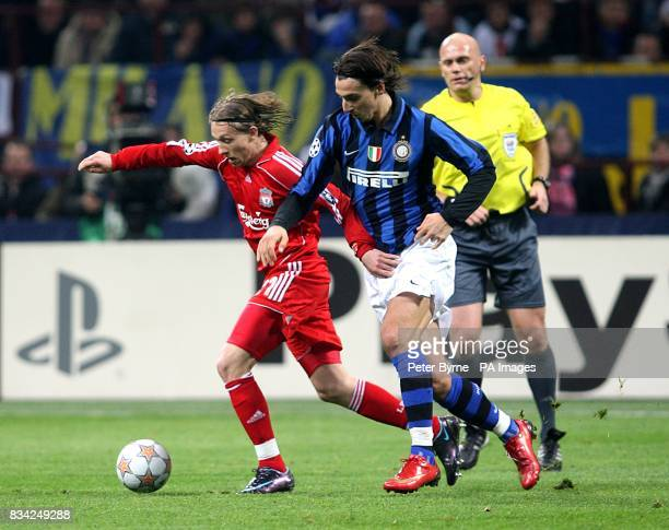 Liverpool's Leiva Lucas and Inter Milan's Zlatan Ibrahimovic battle for the ball