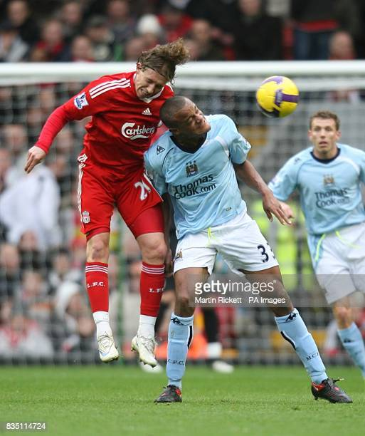 Liverpool's Leiva Lucas and Manchester City's Vincent Kompany battle for the ball