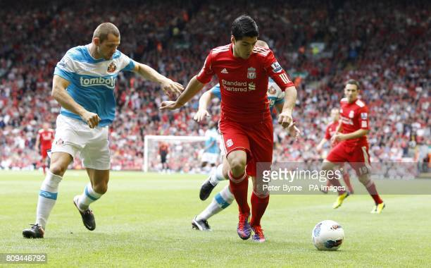Liverpool's Luis Suarez and Sunderland's Phil Bardsley battle for the ball