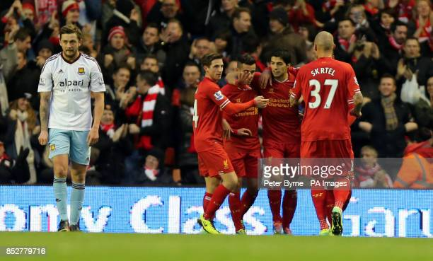Liverpool's Luis Suarez celebrates the opening goal which was credited as an own goal scored by West Ham's Guy Demel during the Barclays Premier...