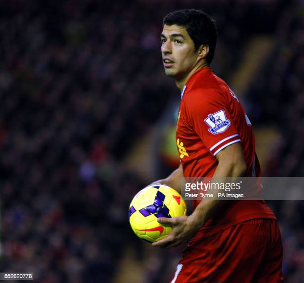 Liverpool's Luis Suarez with the matchball during the Barclays Premier League match at Anfield Liverpool