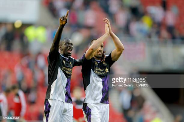 Liverpool's Mamadou Sakho and Jose Enrique celebrate after the Barclays Premier League match Sunderland v Liverpool