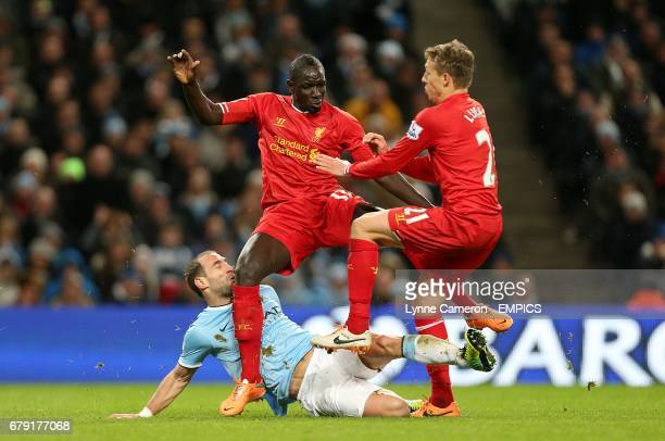 Liverpool's Mamadou Sakho and Leiva Lucas battle for the ball with Manchester City's Pablo Zabaleta