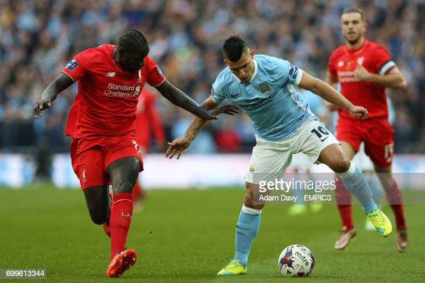 Liverpool's Mamadou Sakho and Manchester City's Sergio Aguero battle for the ball