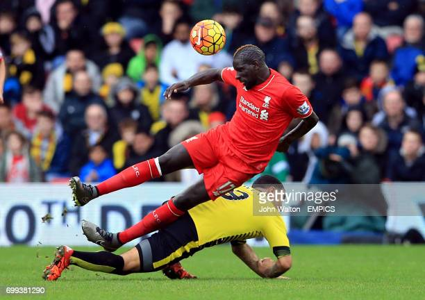 Liverpool's Mamadou Sakho and Watford's Troy Deeney battle for the ball