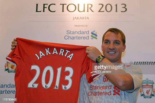 Liverpool's manager Brendan Rodgers holds a Liverpool jersey written 'Jakarta 2013' during a press conference in Jakarta on July 18 2013 Rodgers said...