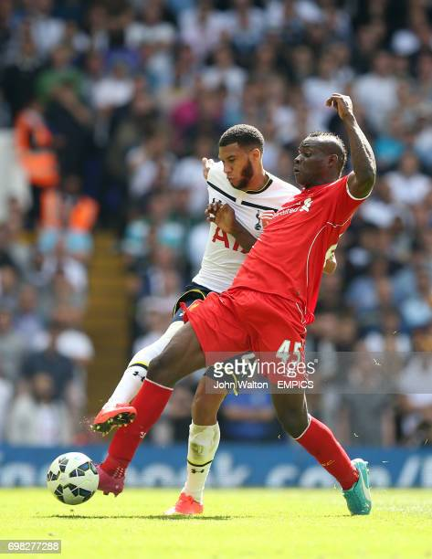 Liverpool's Mario Balotelli and Tottenham Hotspur's Etienne Capoue battle for the ball