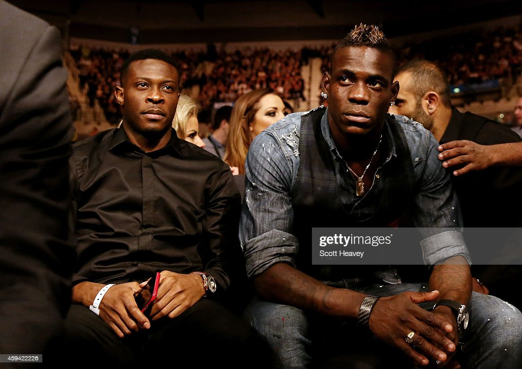 Liverpool's Mario Balotlli looks on from ringside at Liverpool Echo Arena on November 22 2014 in Liverpool England