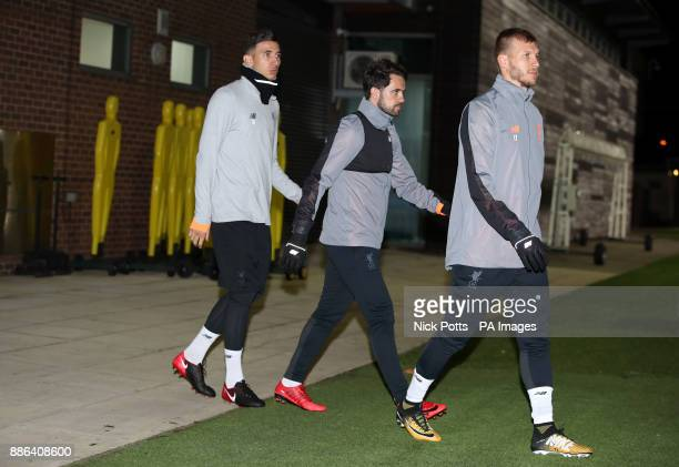 Liverpool's Marko Grujic Danny Ings and Ragnar Klavan during a training session at Melwood Training Ground Liverpool