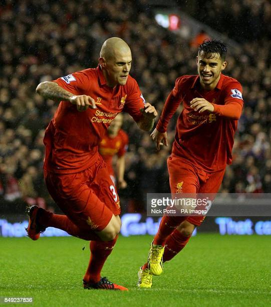 Liverpool's Martin Skrtel celebrates with teammate Suso after scoring his side's first goal of the game