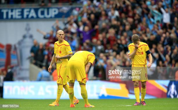 Liverpool's Martin Skrtel Dejan Lovren and Steven Gerrard stand dejected after the match
