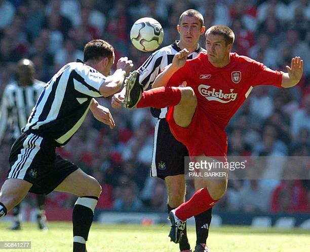 Liverpool's Michael Owen and Newcastle United's Ndy O'Brien vie in a Premiership clash at Anfield Liverpool 15 May 2004