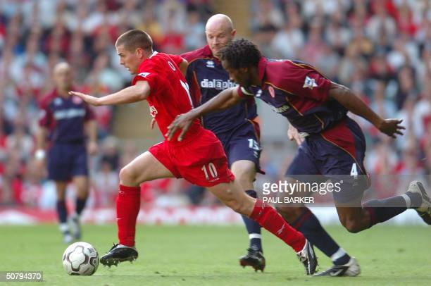Liverpool's Michael Owen breaks away from Middlesbrough's Danny Mills and Ugo Ehiogu in a Premiership clash at Anfield Liverpool 02 May 2004
