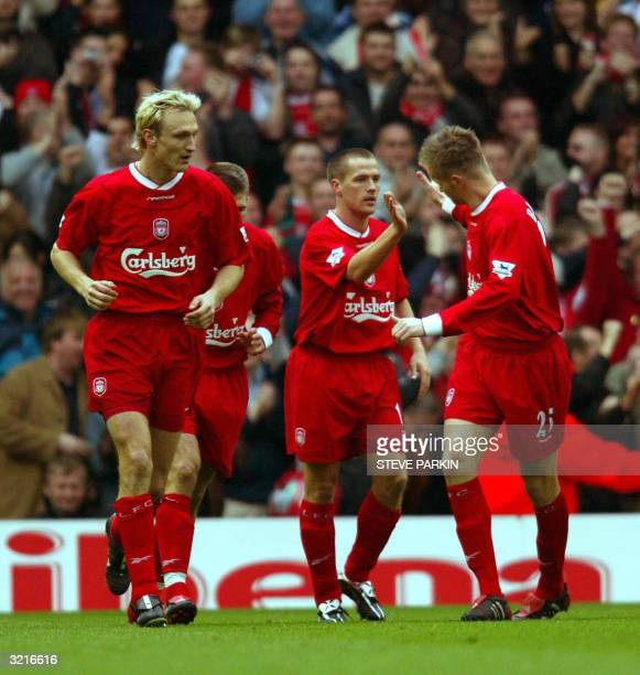 Liverpool's Michael Owen celebrates after scoring his first goal against Blackburn during their premiership match in Liverpool 04 April 2004 AFP...
