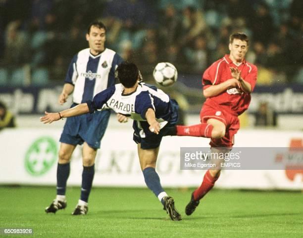 Liverpool's Michael Owen challenges Porto's Paredes