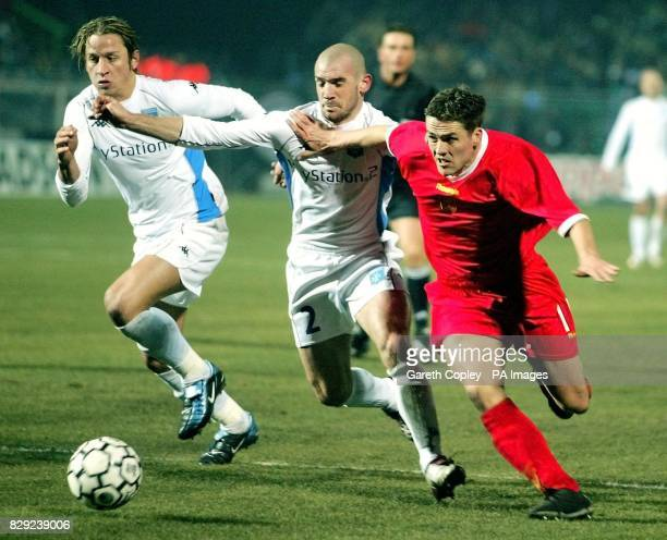 Liverpool's Michael Owen gets past Auxerre's Philippe Mexes and Johan Radet during the UEFA Cup fourth round first leg match at Abbe Deschamps...