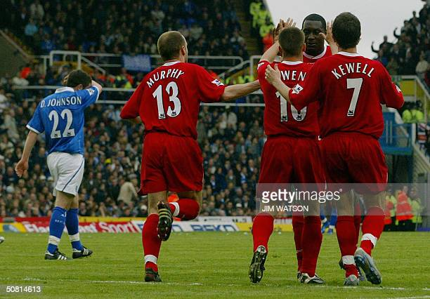 Liverpool's Michael Owen is hugged by teammates Harry Kewell Emile Heskey and Danny Murphy as Birmingham City's Damien Johnson walks away after Owen...